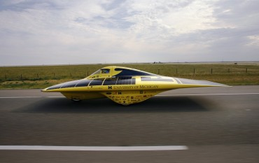 Stock image of University of Michigan's Bailey piloting Continuum in the North American Solar Car Challenge 2008 in Calgary