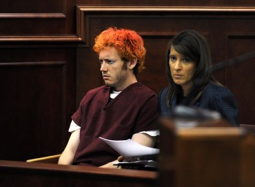 Colorado shooting suspect James Eagan Holmes (L) sits with public defender Tamara Brady during his first court appearance in Aurora