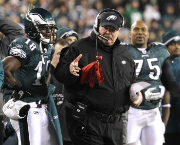 Philadelphia Eagles coach Reid flips his red challenge flag in a game in 2011