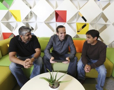 File photo of Dave Girouard (middle) with Google Colleagues