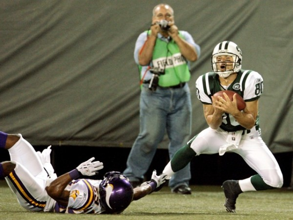 New York Jets Wayne Chrebet (R) gathers in a touchdown pass as Minnesota Vikings Williams falls during their NFL pre-season game in East Rutherford.