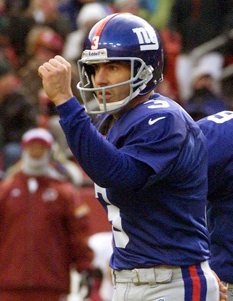 New York Giants kicker Brad Daluiso pumps his fist in the air after kicking a field goal against the Washington Redskins in the first half of their game at FedEx Field in Landover, Maryland