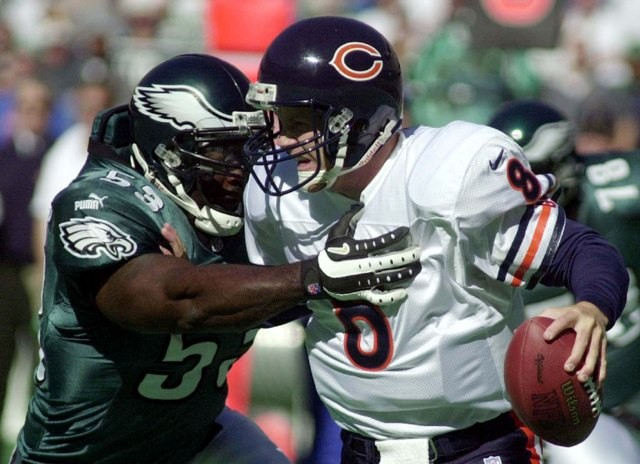 Chicago Bears' quarterback Cade McNown (8) is sacked by Philadelphia Eagles' linebacker Hugh Douglas (53) for a ten yard loss during the first quarter in Philadelphia, October 22, 2000.