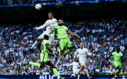 Cristiano Ronaldo of Real Madrid CF heads the ball towards goal under a challenge by Nicolas Otamendi of Manchester City FC during the UEFA Champions League Semi Final second leg match between Real Madrid and Manchester City FC at Estadio Santiago Bernabe