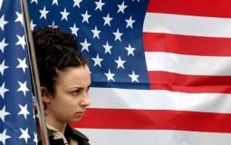 University student holds US flag