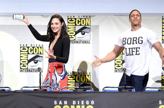 Actors Gal Gadot, taking a selfie, and Ray Fisher attend the Warner Bros. 'Justice League' Presentation during Comic-Con International 2016.