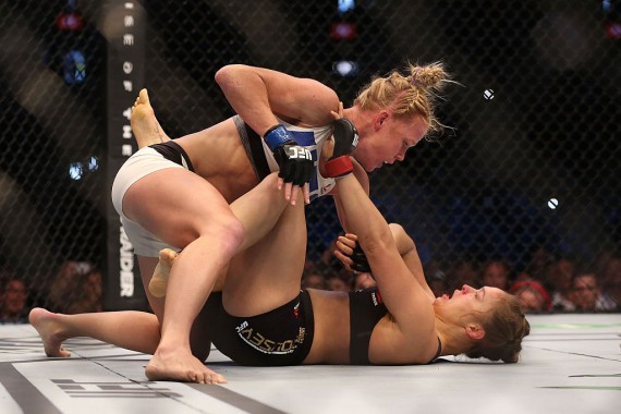 Ronda Rousey of the United States (R) and Holly Holm of the United States compete in their UFC women's bantamweight championship bout during the UFC 193 event