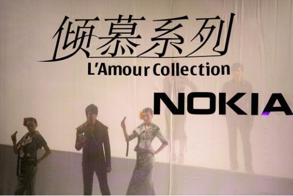 Models display a new series of Nokia mobile phones at a fashion show during the China Fashion Week on November 22, 2005 in Beijing, China.