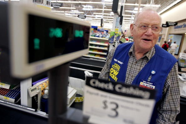 Senior citizen working at a Wal-Mart.