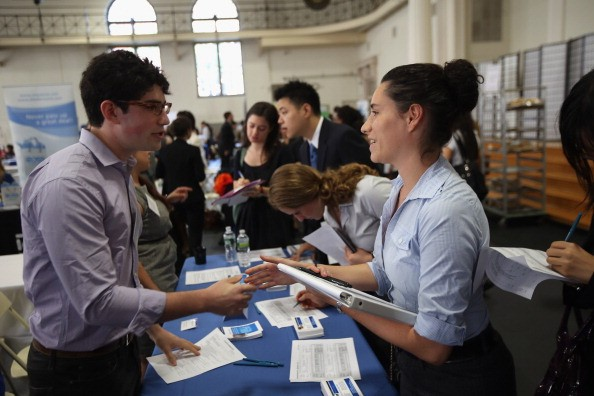 Employers meet with students at a job fair in New York