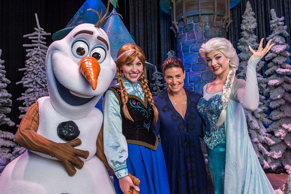 In this handout image provided by Disney Parks, Tony Award-winning actress and singer Idina Menzel poses with Elsa, Anna and Olaf from Disney's 'Frozen' during 'Frozen Summer Fun' at Disney's Hollywood Studios theme park in Lake Buena Vista, Florida.