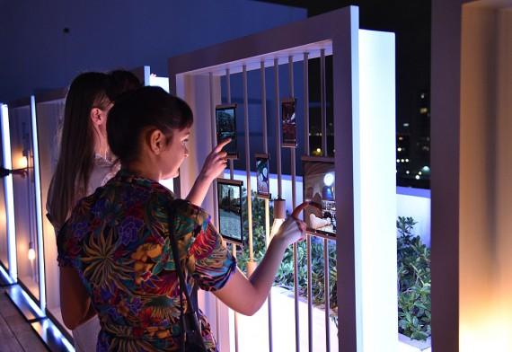 Guests view Prabal GurungÕs Samsung Gear 360 photographs on the Samsung Galaxy S7 and Samsung Galaxy Tab S2 at Ocho at Soho Beach House during Art Basel