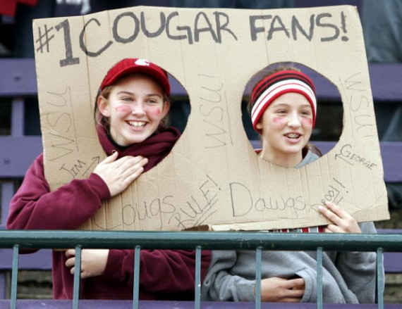 """Cougars fans who bought socks at Bartell's will be surprised to find """"Go Dawgs"""" written on it."""