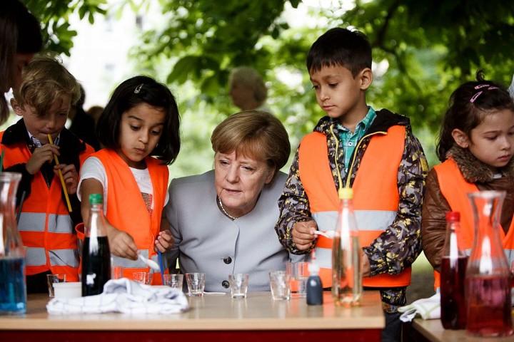 Merkel Visits Berlin Kindergarten