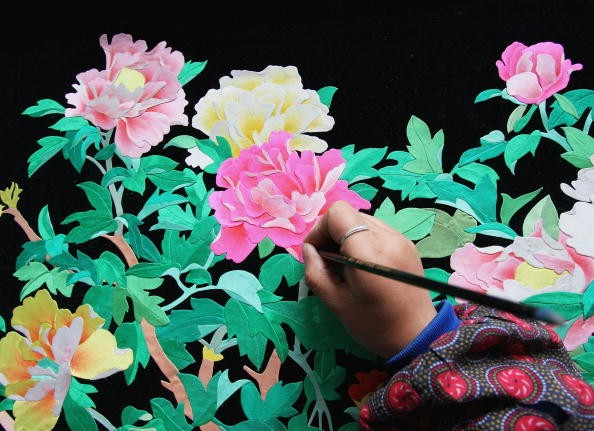 Student makes a painting in a vocational school, an art form that has mental benefits