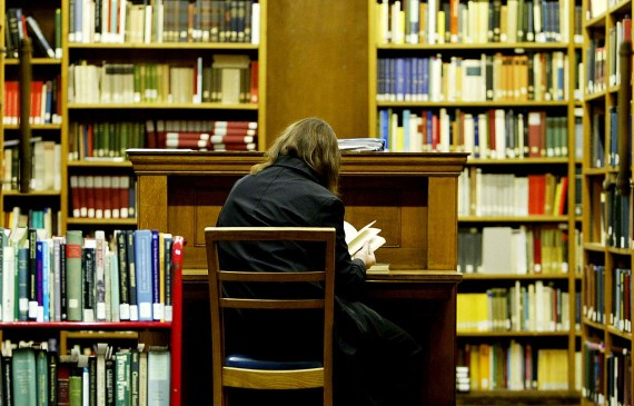 College student studying in the university library in preparation of an upcoming exam.