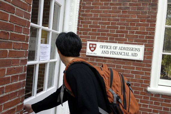 Incoming freshman student enters Admissions Building at Harvard University.