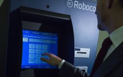 Representatives Of A Bitcoin Kiosk Company Demonstrate The Currency Product On Capitol Hill