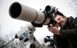 Rupert Smith from Flamsteed Astronomy Society adjusts a telescope outside The Royal Observatory Greenwich