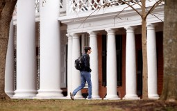 A  fourth year student walks across campus