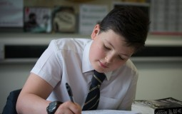 A pupil writes during a test