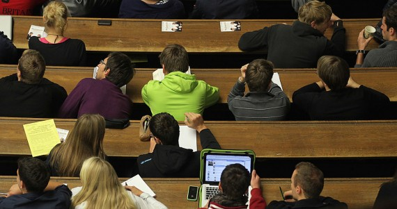 Students attend a lecture in the auditorium