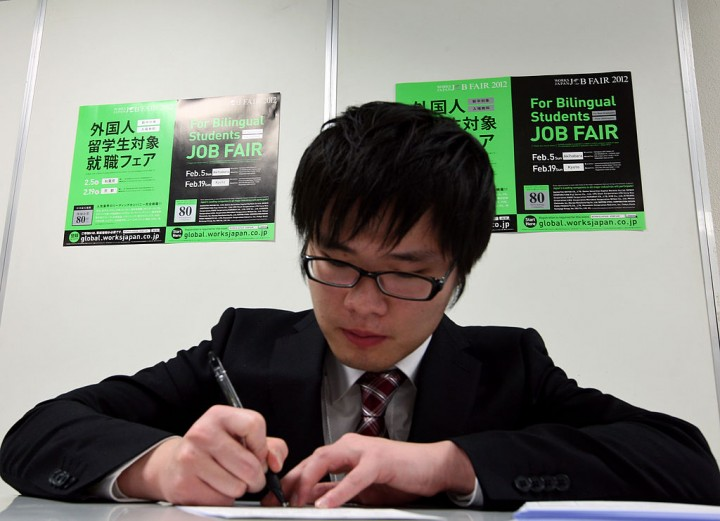 An international student fills out an application for college