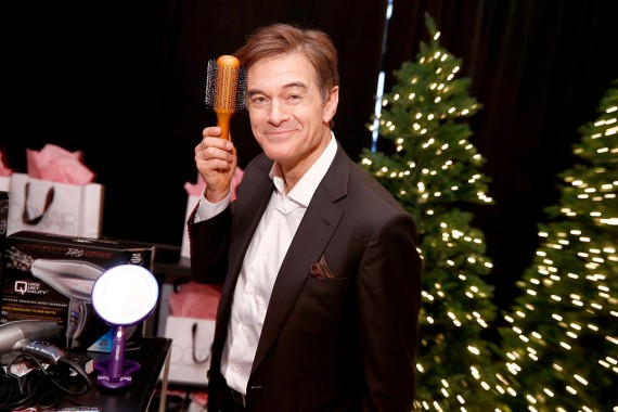 Dr. Mehmet Oz poses with Conair Beauty productsi during Z100's artist gift lounge