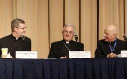 The new DePaul University president will replace Rev. Dennis Holtschneider (L)