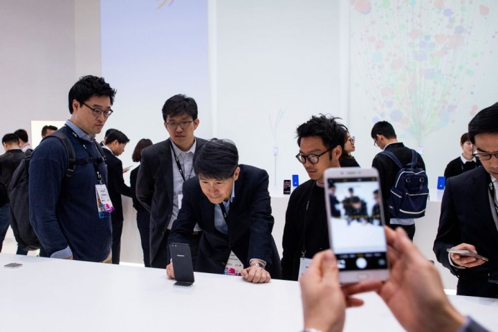 Visitors look at Oppo devices during the Mobile World Congress 2017 on the opening day of the event at the Fira Gran Via Complex on February 27, 2017 in Barcelona, Spain.
