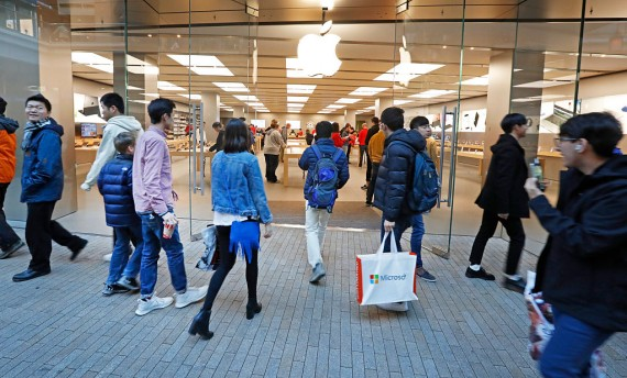 Shoppers walk into the Apple Store at the City Creek Center looking for 'Black Friday' deals