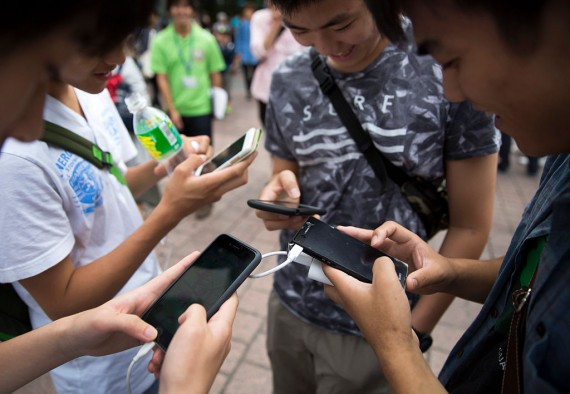 Student engrossed in using their smartphones and social media